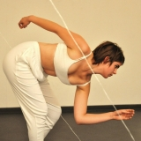 Women in White under clothes, in running pose, liminal strings dividing space.